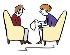 Hier ist eine Skizze/ ein Piktogramm. Darauf sieht man zwei Frauen, die sich in Sesseln gegenübersitzen. Eine Frau hält sich die Hände vor ihr Gesicht, die andere Frau reicht ihr ein Taschentuch.